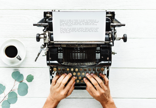 Writing on a typewriter - with a cup of coffee